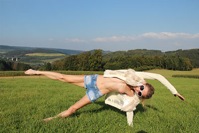 Elke doing nude yoga on a field in Sauerland photo 06