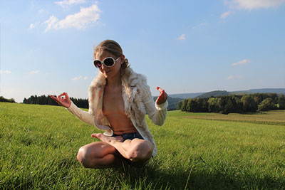 Elke doing nude yoga on a field in Sauerland photo 04