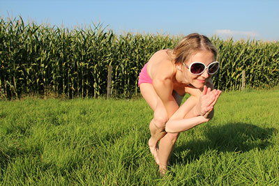Elke doing nude yoga on a field in Sauerland photo 03