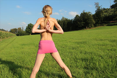 Elke doing nude yoga on a field in Sauerland photo 01