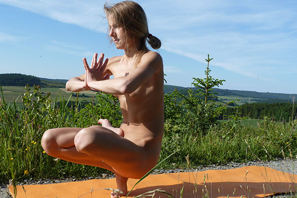 Naked Yoga pose - the toe stand